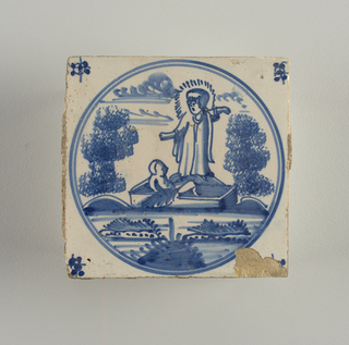 Square tile, blue and white. A circular border encloses biblical scene, probably Moses in the bulrushes. Robed figure with nimbus stands on mound behind baby in rectangular boat, Tree on each side. Floral corners.