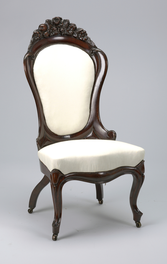 (D)  Upholstered, laminated rosewood back in shape of inverted pear, topped by carved flowers-and-fruit garland; elongated S-scroll on each side of back.  Upholstered spring seat on rosewood frame with serpentine front, cabriole forelegs with slipper seat, scrolled at each side, on tapered supports; reverse-curve rear legs; casters.