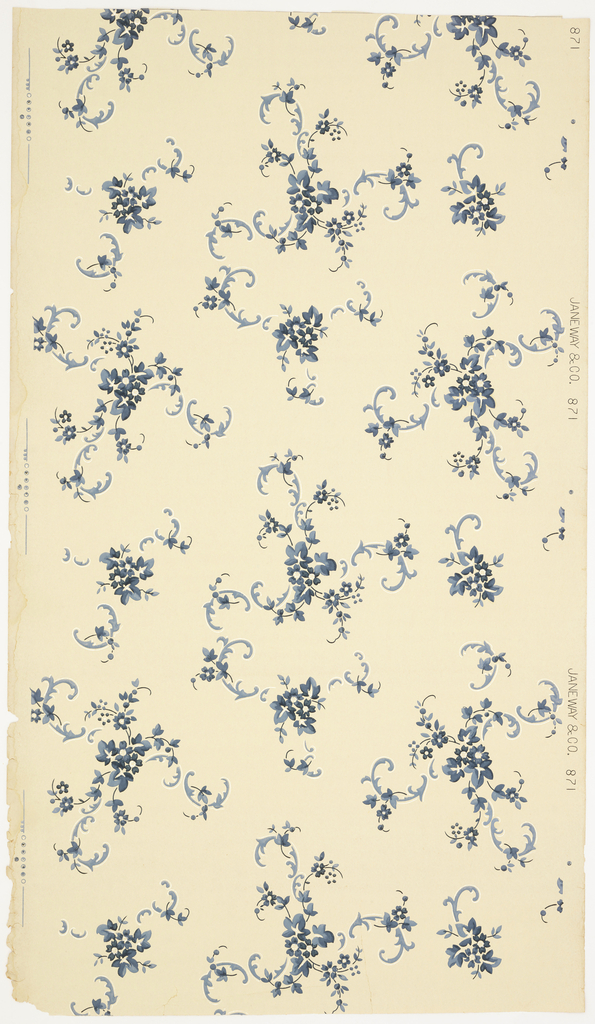 Overall cluters of floral scrolls and flowers. Printed in blues and white mica on off-white ground.
