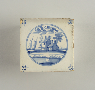 Decorated in blue on white, with landscape, with house and two boats, enclosed within two concentric circles.