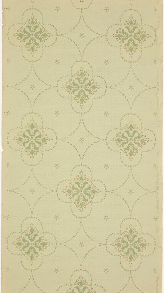 Bead and reel quatrefoils connected by bead and real swags with floral medallions in each quatrefoil. In the resulting negative space are simplified flowers. Background of dash and dot pattern. Ground is light green. Printed in gold mica and greens.