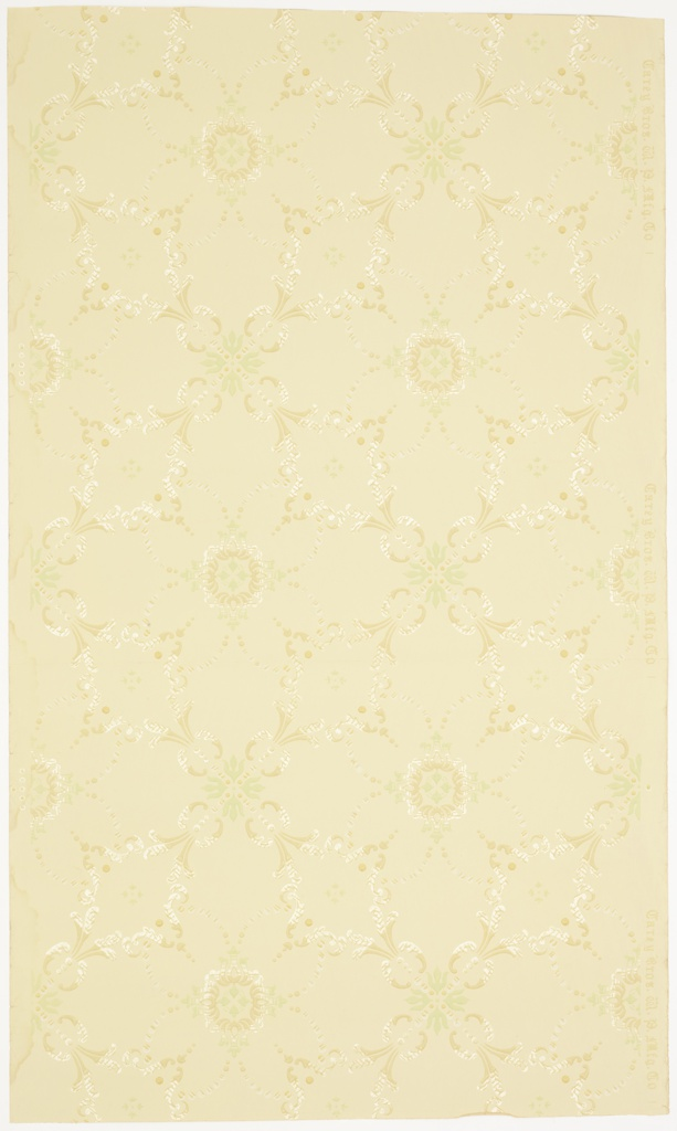 Alternating floral motifs connected by beading, scrolls, and beaded swag, forming a treillage pattern. Ground is beige. Printed in green, white, white mica, and tans. 