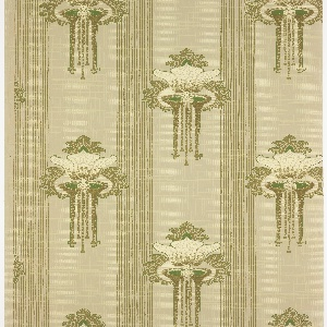 Vertical bands of thin green stripes alternating with bands of a large stylized flower motif with mosaic-like details. Background has a grid of square dots and intersecting vertical and horizontal lines. Ground is light green. Printed in greens, brown greens, and cream.