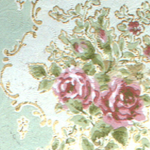 Garland of roses and small rinceaux forming a heartshape with rose motif set in its top. Small cinquefoils are placed inside the heartshape. On each side is a large rose placed in a bouquet. A floral garland is running along the border. Printed in shades of red, green, gold mica, pale blue and off-white.