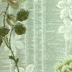 Longstemmed roses, running vertically, with cinquefoil flowers between the roses. A textured background with horizontal line effects gives the look of tapestry. Printed in blue, yellow, green and rust-color.