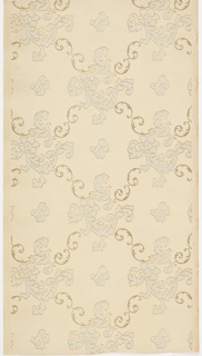 Lattice pattern of scrolls with medallions of scrolling foliage and flowers. Printed in light blue, white liquid mica and gold liquid mica on pink-beige ground.