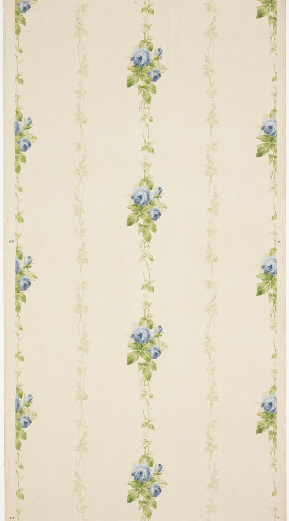 Alternating vertical vines of closed and open blue flowers. Background is covered in small white mica dots. Ground is white. Printed in blues, greens, and white mica.