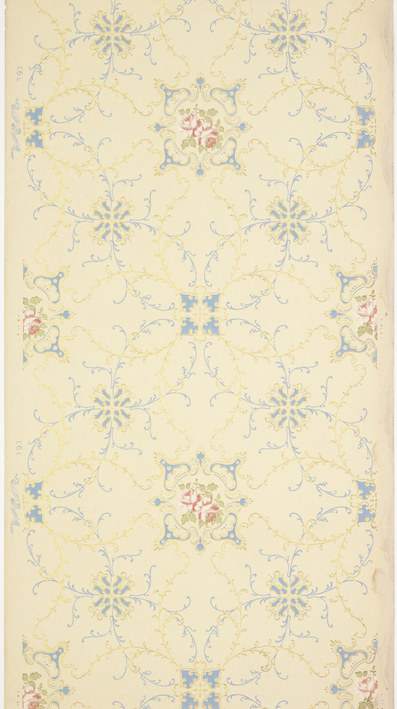 """Alternating large floral medallions with rose insets and scrolls and two fleuron motifs, all connected by extensive foliate vining. Printed in light blue, pinks, green liquid mica and gold mica on a cream-beige ground. Printed in selvedge: """"Standard Papers"""" pattern number """"393""""."""