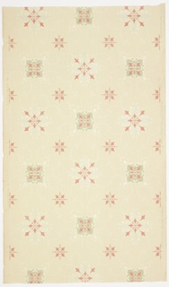 """Band of large blue and link and medium green and pink fleurons alternating with band of small green and pink fleurons. Fleurons are connected by white mica scrolls with sylized floral pendants. Printed in light green, pink, blue liquid mica and white liquid mica on light beige ground. Printed in selvedge: """"S.A. Maxwell & Co. New York & Chicago"""" ; """"Exclusive Design No. 2379""""."""