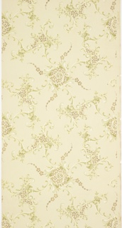 "Large waving scrolls with foliate scroll tendrils that alternate with other foliate scroll motifs. Each motif is filled with a simplified petal design, and the large waving scrolls have tendrils of the simplified petal design. Ground is light green. Printed in greens, yellow, white mica and gold mica.  Printed in selvedge: ""Janeway & Co."""