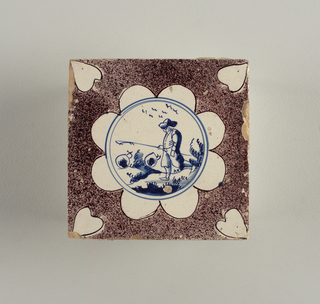 Earthenware in manganese, white and blue.