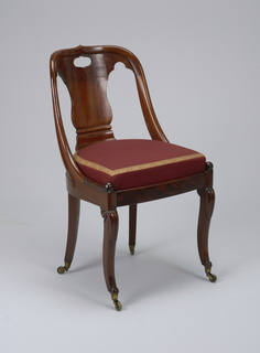 Straight-sided front legs, set square, curving outward toward voluted foot; lotus leaf carved on knee, with volute in side of knee. Back legs square in section, curving outward from centre. Plain veneered seat rail semicircular on back straight on sides, slightly bowed in front. Back, with ogive cresting, descends in curve to join seat rail, terminating in slightly scrolled lotus leaf carved above front leg; fiddle-shaped splat in back, with pierced hand-grip hole above. Slip seat upholstered with red silk damask, edged with brocaded trimming in red and yellow.
