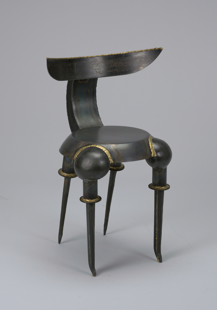 Chair composed of horizontal back on vertical support attached to circular seat (steel skillet and skillet sections) on four tapering legs (inverted steel ladles), all patinated bronze to brown in color.