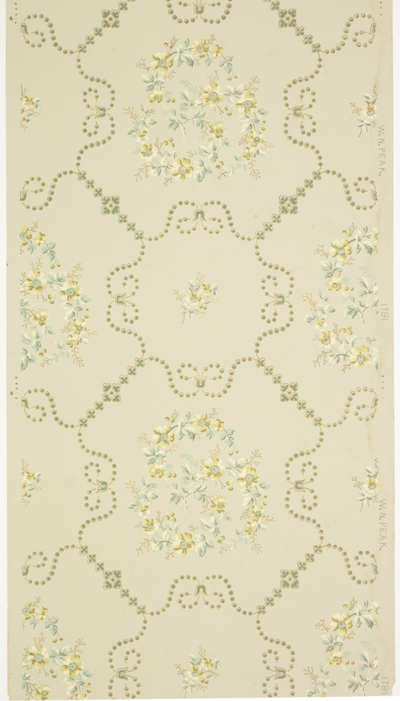Scrolling floral branches and small floral motifs in a large geometric grid of beaded and stylized floral vining. Printed in blues, beiges, cream and metallic gold on grey-blue ground.