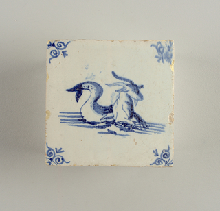 Bluish-white field. In center, blue sea-goat riding upon water. In corners, scroll decoration.