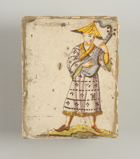 Man in manganese coat and yellow umbrella shaped hat, playing a guitar like instrument. Chinoiserie type of decoration.