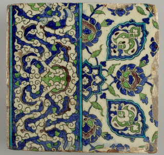 Border tile decorated in white, cobalt, turquoise, apple-green, and purple with black lines. Lower portion forms part of a continuous arabesque frieze featuring interwoven cloud bands. Upper half composed of two quadrants of a four quadrant repeating design, make up of a system of conventionalized blossoms, leaves, stems, and arabesques in shaped cartouches.
