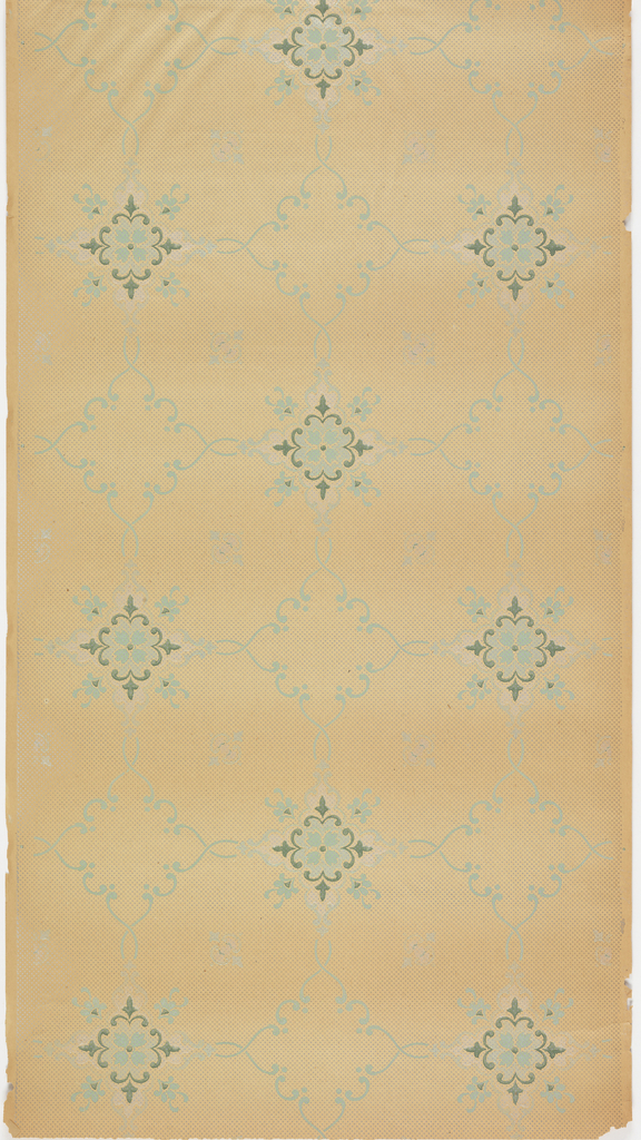 Floral medallions connected by foliate scrolls, creating a treillage pattern. Background of dots. Ungrounded and printed in teals, green, white mica, blue, and blue mica.