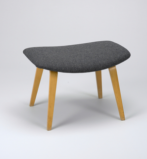 Contoured, rectangular seat covered in gray wool; four simple bentwood legs.