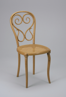 "Curvilinear, bentwood side chair with curved front legs, straight rear legs; roughly square shaped caned seat, and curving back with sinuous, ""heart""-shaped bentwood elements."
