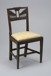 Chair has an open rectangular back.  Upper panel is pierced and carved with perspective view of avenue of poplars leading to an arch.  Moulded seat rails receive slip seat.  Front legs are straight, flat, square, and tapered.  Two transverse and two longitudinal stretchers.