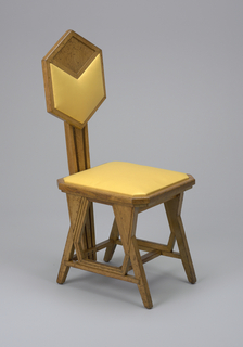 Side chair with octagonal seat, hexagonal back supported by three central vertical members which rise from seat stretcher. Slanting legs form triangular voids and irregular hexagonal voids at intersections with stretchers. Slip seat and back panel covered in yellow chintz (reproduction).