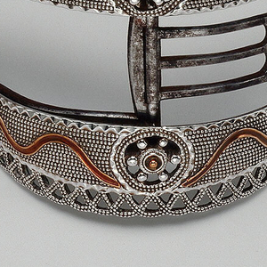 Pair of English gentleman's shoe buckles with two circular patterns and framed by knotted openwork.