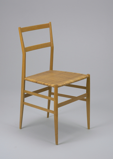with turned legs and uprights champfered at the angles, the chairback with slight back angle connected by horizontal slats, the seat with woven close-caning in a twill weave, the chair legs connected with slat-form stretchers, one on front and back, two on each side.