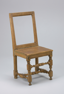 This side chair is comprised of turned stretchers, a flat seat, and an open back.  The void rectangular area of the chair's back may have been filled with webbing at one point.  The chair rests on elaborately carved legs and feet.