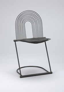 Back of black steel tubing sculpted into a semi-circle; similar seat with thin, circular, leather seat cushion.  Curved tubular base with straight tube at front.  Two straight tubes canted toward rear connected to straight tube at back of seat.  All steel enameled matte black.