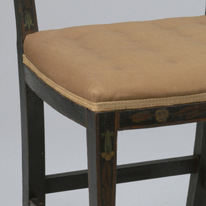 Three, curvilinear-shaped splats characterize back.  Upper posts are tapered.  Two lateral and two longitudinal stretchers.  Upholstered seat (light pink).