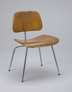 Molded laminated plywood seat and back panels connected by bent tubular steel frame. Rubber gaskets connecting steel to wood. Metal pad feet.