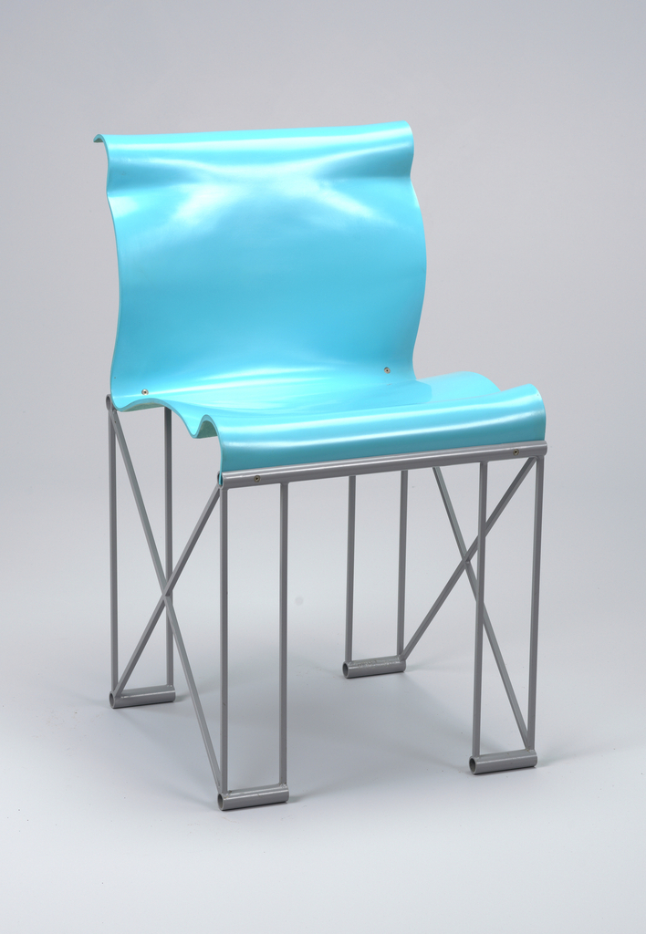 A blue resin chair with black steel legs. The seat is a wavy blue resin resembling a ribbon. The legs are made of steel forming rectangles with crossed metal on the side connecting two legs.