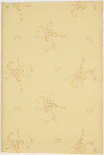 Sparsely arranged floral and foliage scrolls.  Gold and shades of pink on a pale yellow ground.  Pattern number 0563.