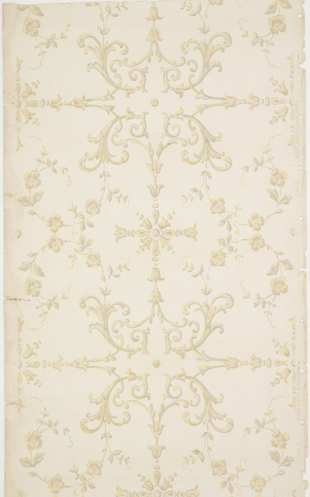"""Scrolls of vine and flowers.  Grey, tan color with gold highlights on a white background.  Holes punched in selvage. Pattern number: """"2913""""."""