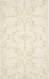 "Scrolls of vine and flowers.  Grey, tan color with gold highlights on a white background.  Holes punched in selvage. Pattern number: ""2913""."