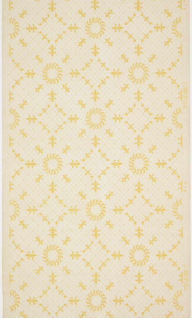 Quatrefoil pattern composed of fleur de lis, with a wreath in the center of each. Overall background pattern os small grid or trellis. Printed in yellow ocher on tan ground.