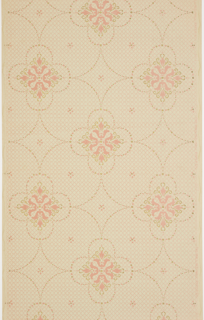 On light blue ground, floral motifs composed of four pink flowers with green scrolls surrounded by scalloped frame and linked by treillage.