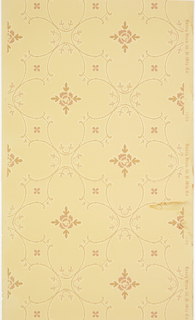 Reating pattern of ogival shapes or quatrefoils printed to resembe a woven textile or cord applique. Four-pointed floral motif in center of each. Printed in tan and white on light tan ground.
