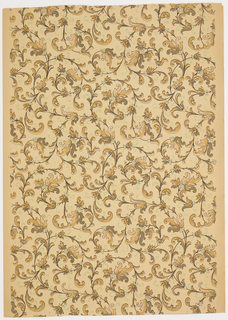 All over pattern of scrolling acanthus vines. Printed in shades of tan, brown, and greeon on ungrounded paper that is now tan.