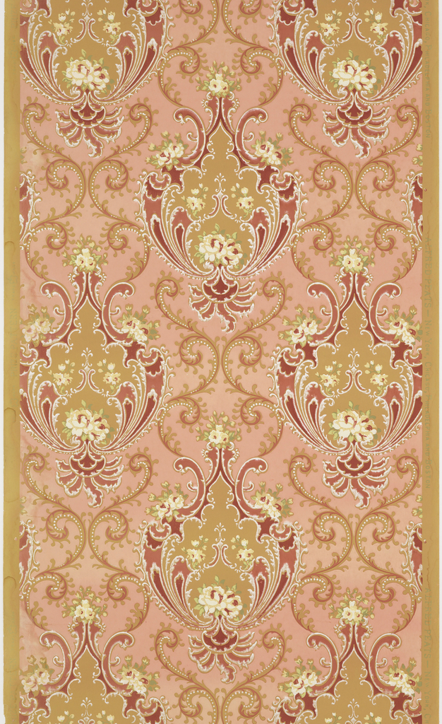 Large-scale floral and scroll medallions. Each medallion is printed in shades of pink and contains multiple small white flowers. The background is pink printed on a deep tan ground.