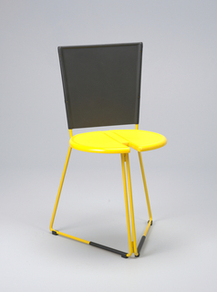 Frame of chair (a) formed of two yellow enamelled steel rods, each trapezoidal to form base, with extended uprights for back. Black plastic skids on base bottom rods. Base rods hinged at one side: when open, form two sides of triangular base; flat when closed. One side with hinged yellow molded plastic seat with spring level beneath to secure to second base rod when opened. Two uprights hold molded removable rubber back (b) which folds when closed. Front of plastic molded seat notched to accomodate side rods when folded flat.