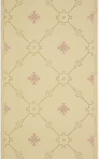 Pink and green cross motif centered within a grid design. Also printed in metallic gold on tan ground.