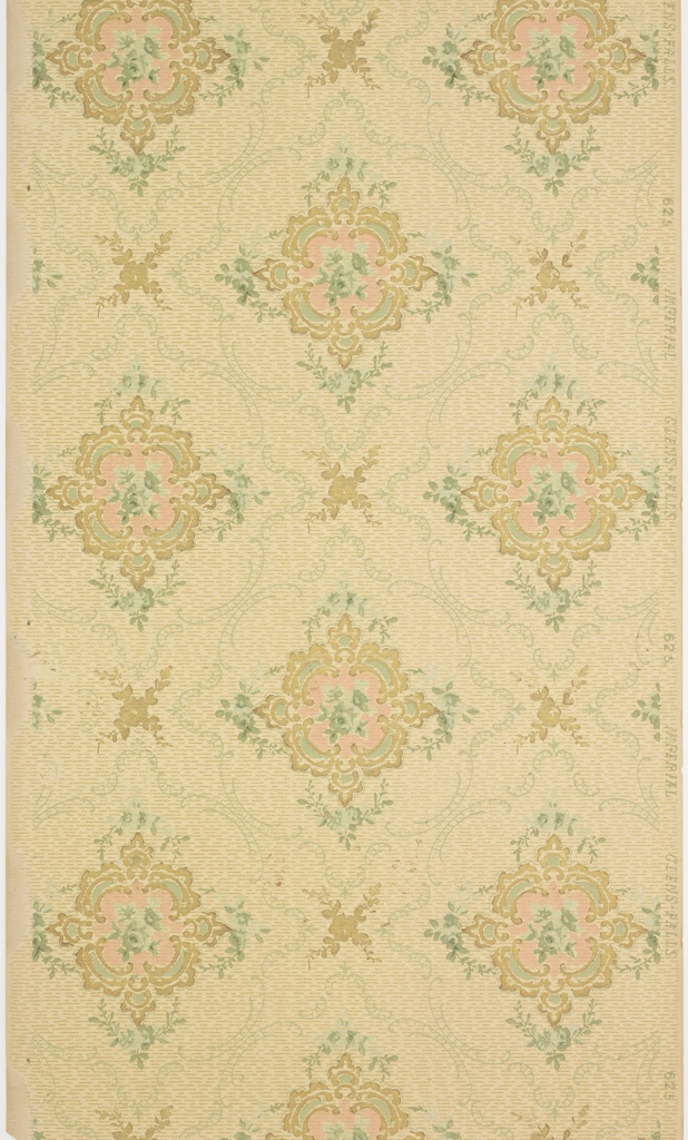 Mostly pink, squarish medallions, repeating diagonally. Printed in pink, green, metallic gold on tan ground.