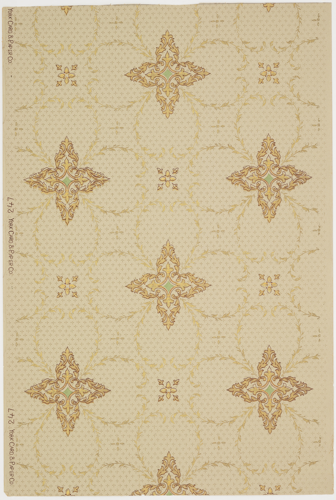 Pointed quatrefoil motif with green center enclosed within larger rounded quatrefoil motif composed of foliage swags. Printed in metallic gold, green, and deep red on a light tan ground.