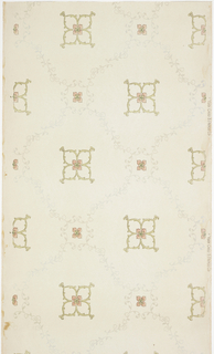 Trellis or grid pattern with a folaite quatrefoil motif in the center of each grid, and a four-petaled flower in a square where the lines would intersect. Printed in pink, green, and gray on light off-white ground.
