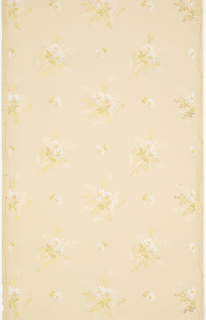 Subtle pattern of larger floral sprigs alternating with single flower motifs. Printed in white, ocher, and metallic gold on light tan ground.