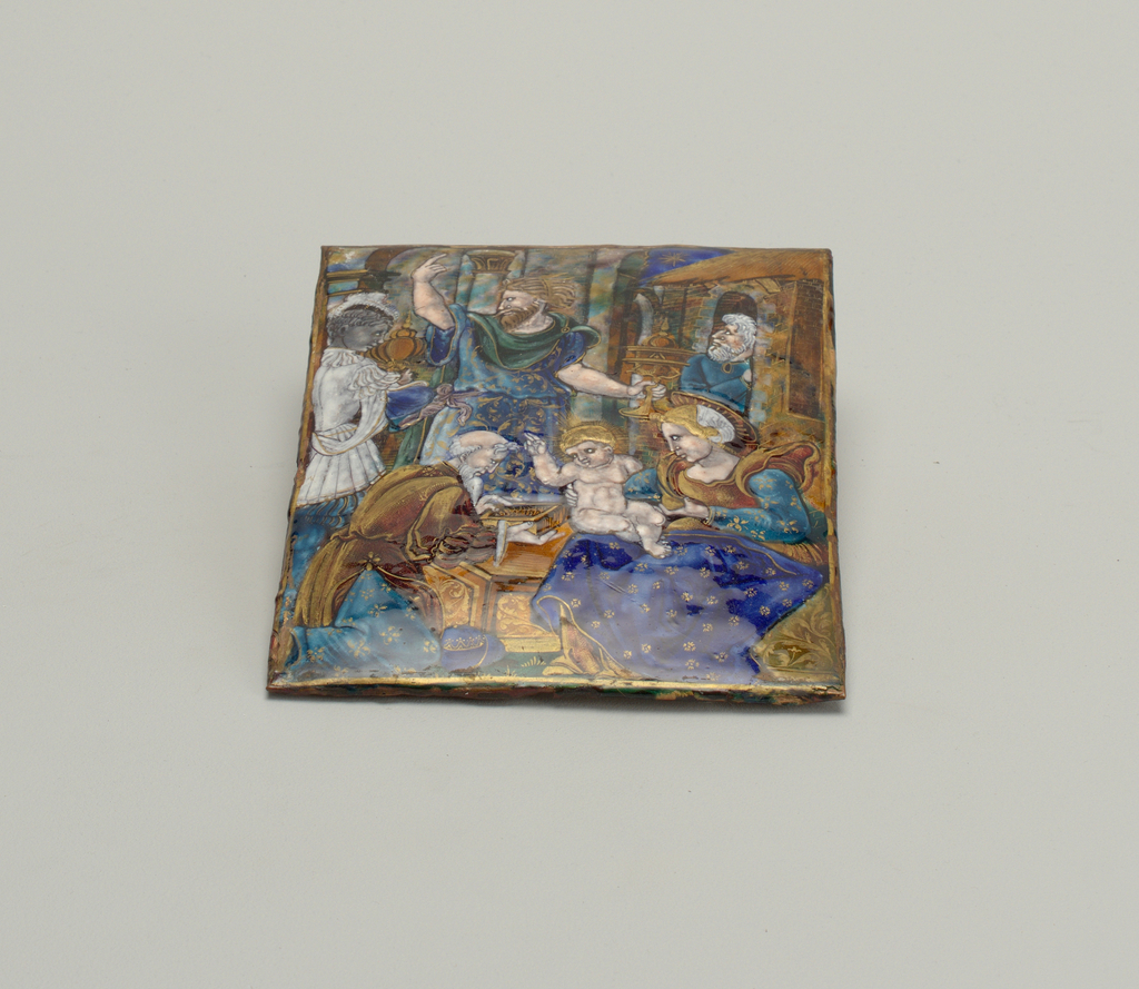 """Scene depicted is """"Adoration of the Magi."""" In foreground is seated the Virgin, dressed in sixteenth-century-style costume (dark blue, light blue, red, with gold decoration), holding nude child on lap. Child blesses bearded man kneeling, presenting box. Behind in center is Joseph(?)--or someone worthy of a crown--holding a covered goblet in one hand, other hand upraised. Servant-like figure on left in white with gold-trim costume, also holding covered object. On right is a bearded man in blue tunic standing in archway. Much use of translucent enamels and gold detailing. Colorful marble-like wall behind scene. No indication of a signature."""