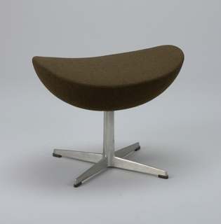 Lounge chair (a) of ovoid form, upholstered in brown woven fabric, on cast and polished aluminum base consisting of short shaft above four splayed metal feet; seat cushion (b). Ottoman (c) upholsterd in same brown fabric, also on aluminum base.