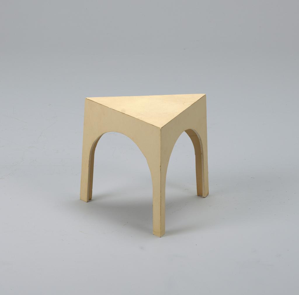 Triangular stool.
